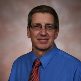 A man in a blue shirt and a tie
